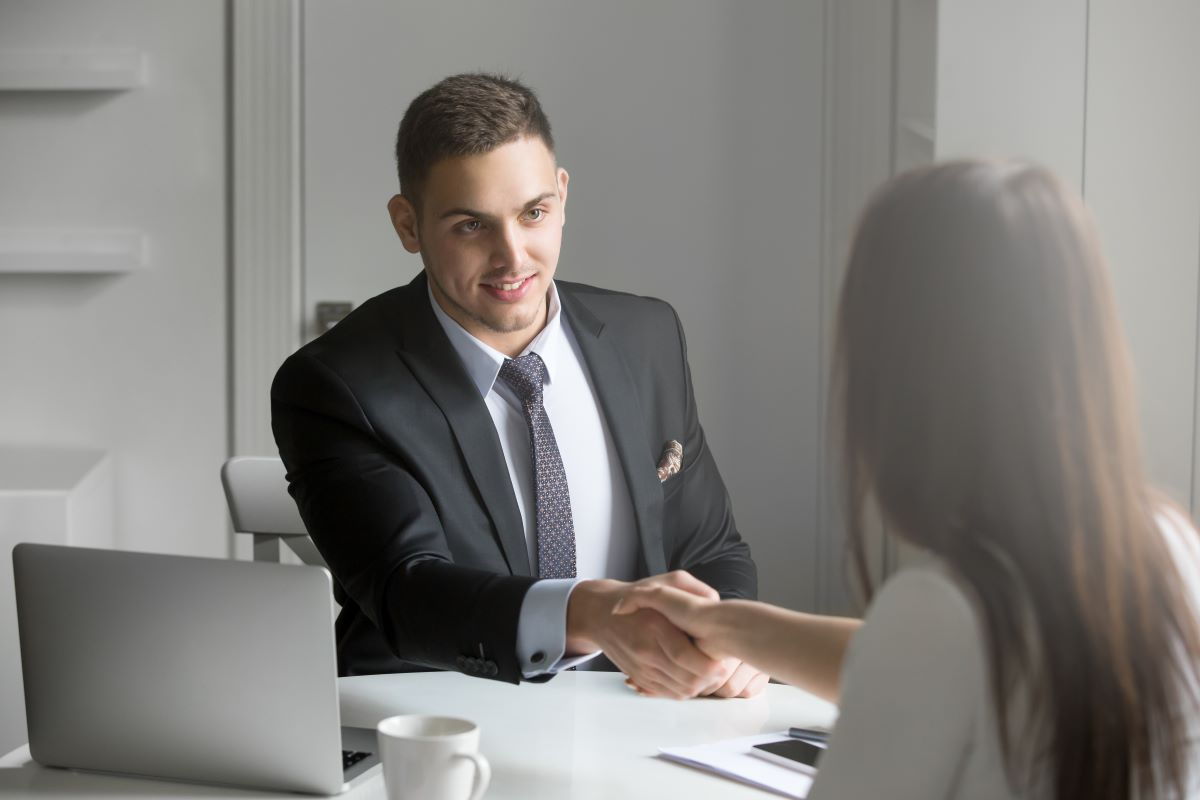 man shaking hands accepting employee