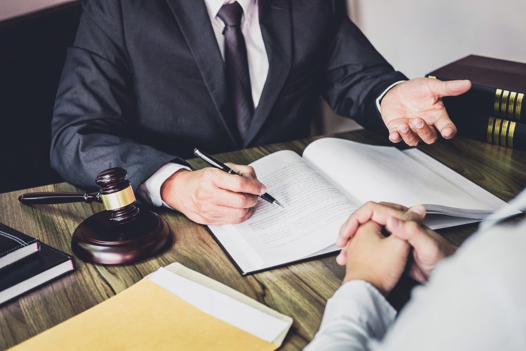 a lawyer discussing to a person